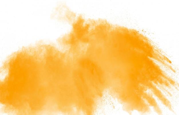 Абстрактный желтый оранжевый порошок взрыв на белом фоне. Premium Фотографии