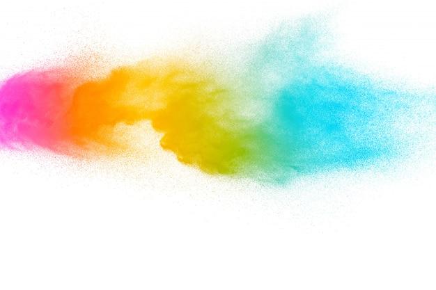 白い背景の上の抽象的な多色粉体爆発。 Premium写真