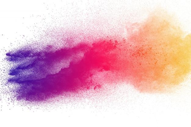 カラフルな粉体爆発。抽象的なパステルカラーのダスト粒子の飛散。 Premium写真