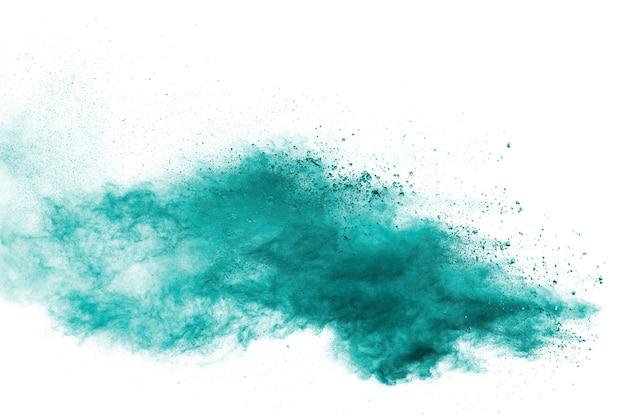緑の塵粒子爆発白い背景。 Premium写真