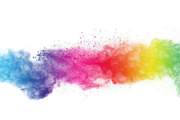 Красочный взрыв порошка на белой предпосылке. абстрактные пастельные цвета пыли частицы всплеск. Premium Фотографии