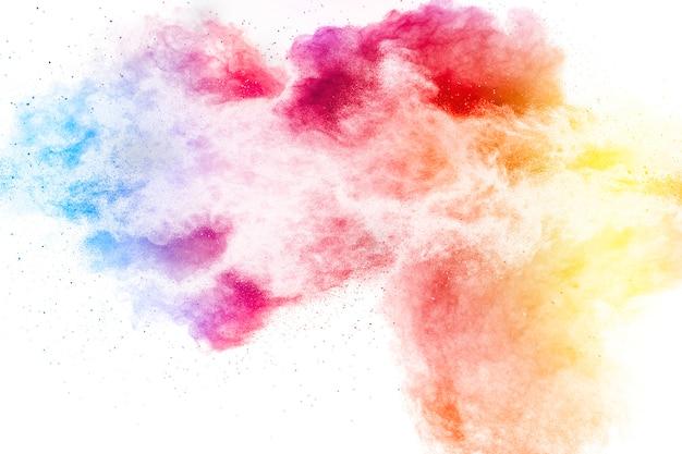 Взрыв разноцветных частиц пыли на белом поверхности Premium Фотографии