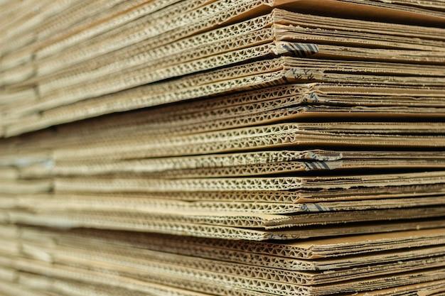 Картон коричневой бумаги предпосылки наслаивает текстуру. Premium Фотографии