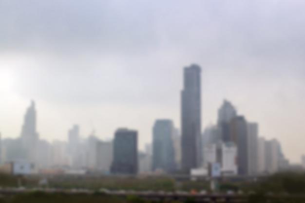 Нерезкость загрязнения окружающей среды ландшафта с высоким зданием в городе. изображение предпосылки. Premium Фотографии