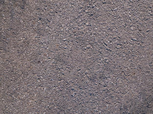Поверхность черного асфальта или дороги текстуры фона Premium Фотографии