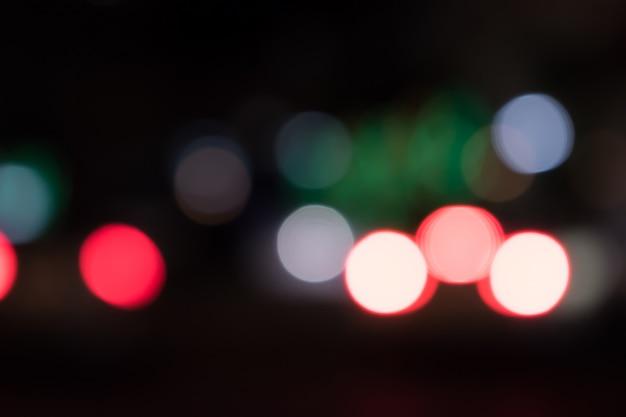 夜の車のライトからのボケ味 Premium写真