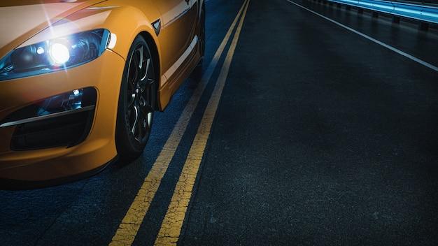 夜の道路上の黄色の車。 Premium写真