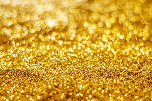 キラキラ光の抽象的なゴールドのボケ味がぼやけて背景 Premium写真