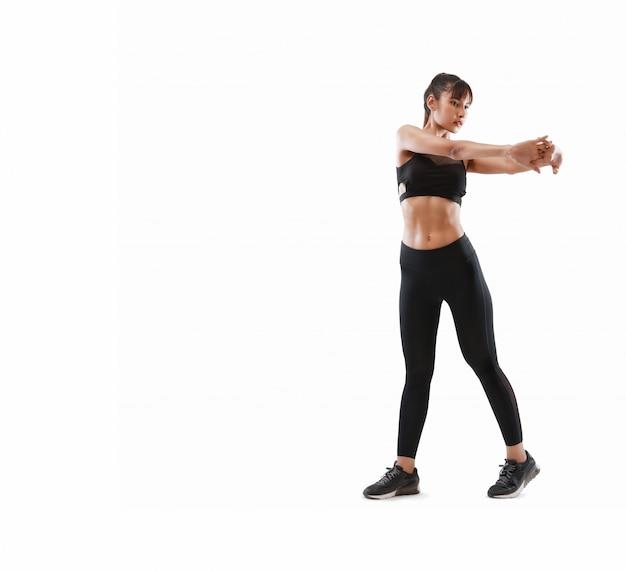 スポーティで魅力的な女性は分離したフィットネス運動を行う Premium写真