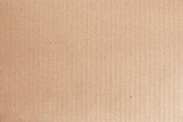 段ボールシートの抽象的な背景、古いビンテージパターンのリサイクル紙箱の質感。 Premium写真
