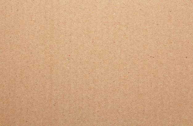 茶色のボール紙シートの抽象的な背景、古いヴィンテージのリサイクル紙箱の質感 Premium写真