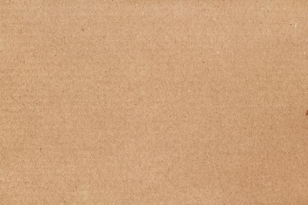 茶色の段ボールシートの抽象的な背景、デザインアート作品の古いビンテージパターンでリサイクル紙箱のテクスチャ。 Premium写真