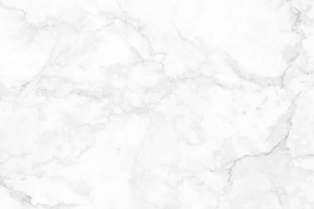 高解像度の自然なパターンの白灰色の大理石のテクスチャ背景、インテリアとエクステリアの豪華な石の床のシームレスなキラキラをタイルします。 Premium写真