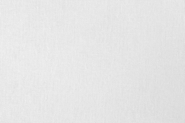 Текстура белой хлопчатобумажной ткани, бесшовные модели из натурального текстиля. Premium Фотографии