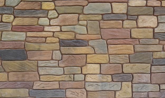 抽象的な石タイルのテクスチャレンガの壁の背景。 Premium写真