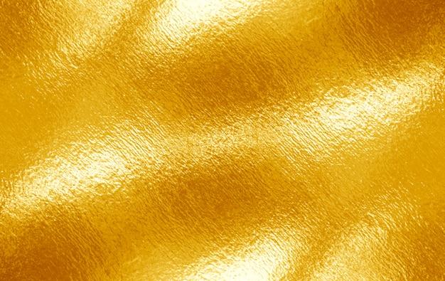 光沢のある黄色の葉の金箔の質感 Premium写真