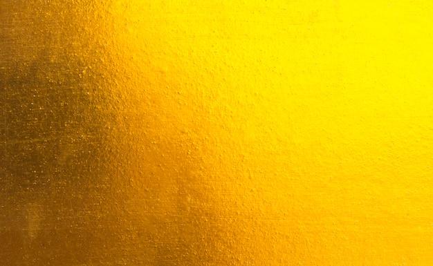 光沢のある黄色の葉金の金属の質感 Premium写真