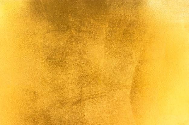 光沢のある黄色い葉の金箔の質感 Premium写真