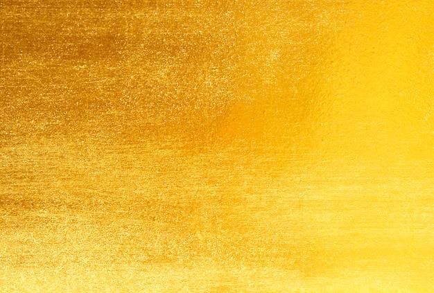 光沢のある黄色い葉金箔 Premium写真