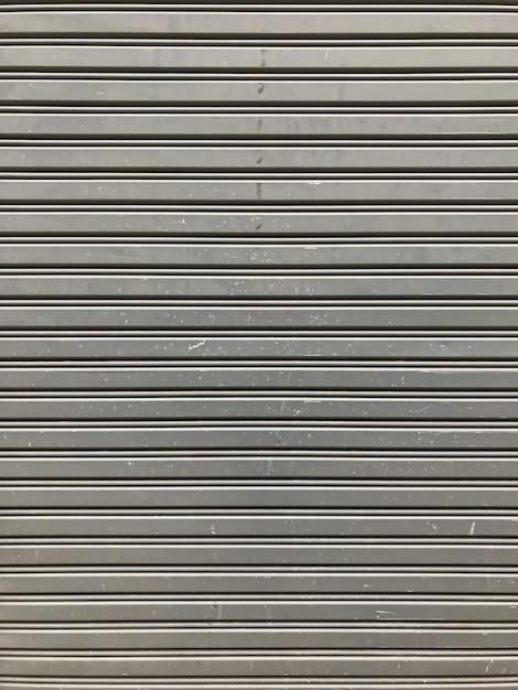 灰色の小売店小売メタルゲートの壁が閉じられた。 Premium写真