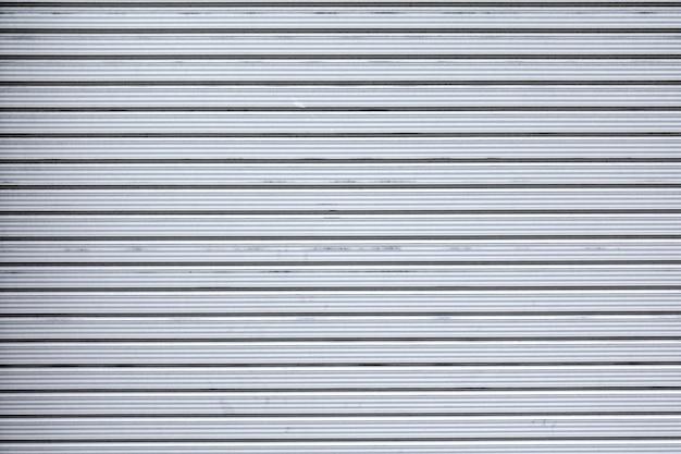 グレー店小売メタルゲートの壁は閉まった。 Premium写真