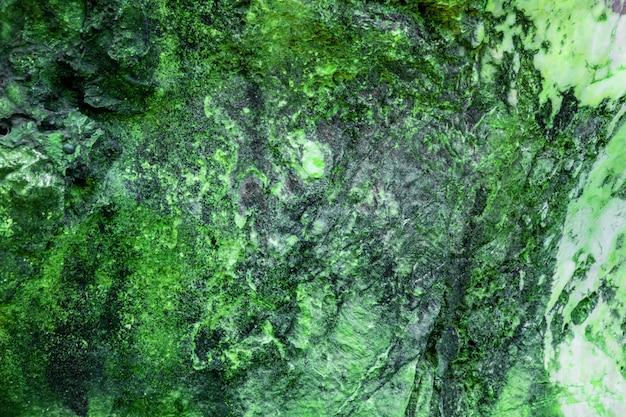 グリーンロックのカラフルな質感地質学テクスチャ背景 Premium写真