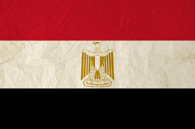 古いヴィンテージの紙のテクスチャの背景とエジプトの国旗 Premium写真