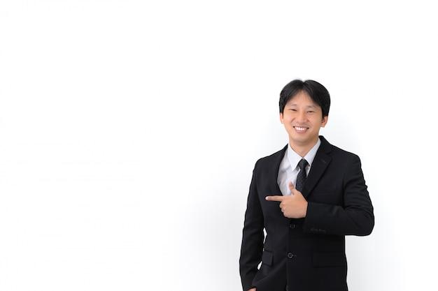Закройте вверх по портрету костюма азиатского молодого красивого бизнесмена нося с связью Premium Фотографии