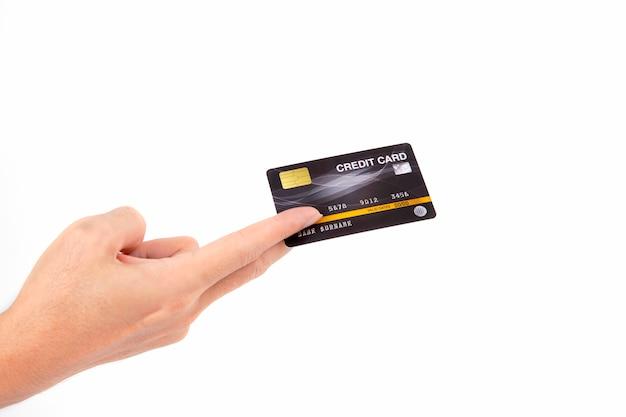 白で隔離されるクレジットカードを持っている手 Premium写真