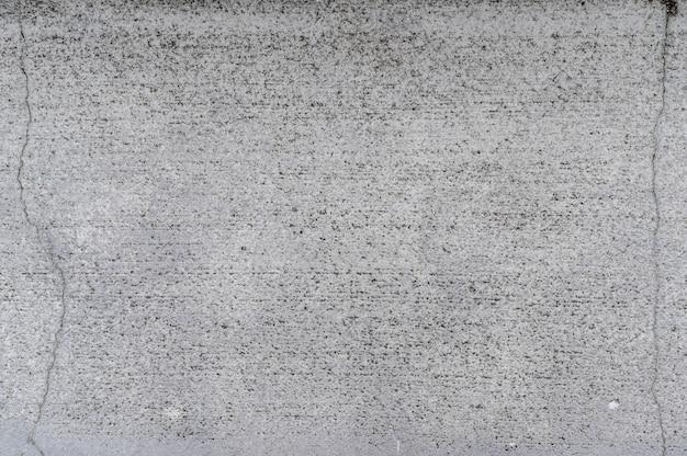 亀裂テクスチャ背景を持つ灰色のコンクリート Premium写真