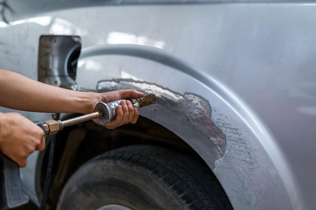 Макрофотография машина для ремонта кузова автомобиля и покраска с профессиональным сервисом Premium Фотографии