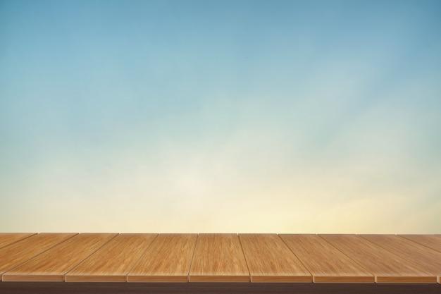 Деревянный стол с видом синий фон. вы можете использовать для отображения продуктов. Premium Фотографии