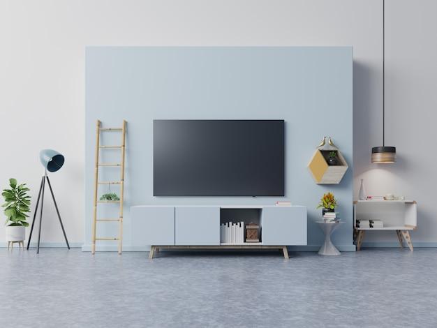 モダンなリビングルームのキャビネットのテレビには植物と青の本があります Premium写真
