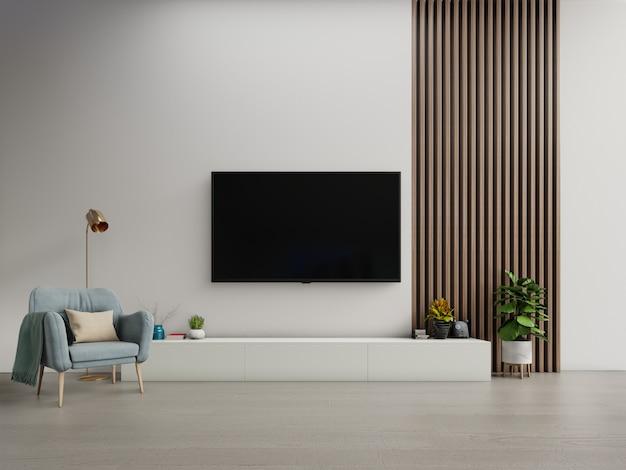 白い暗い壁に肘掛け椅子とモダンなリビングルームのキャビネットのテレビ。 Premium写真