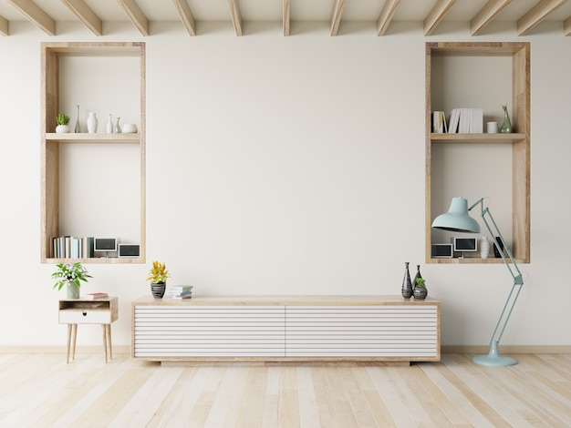 モダンなリビングルームの木製の床にキャビネットテレビ。 Premium写真