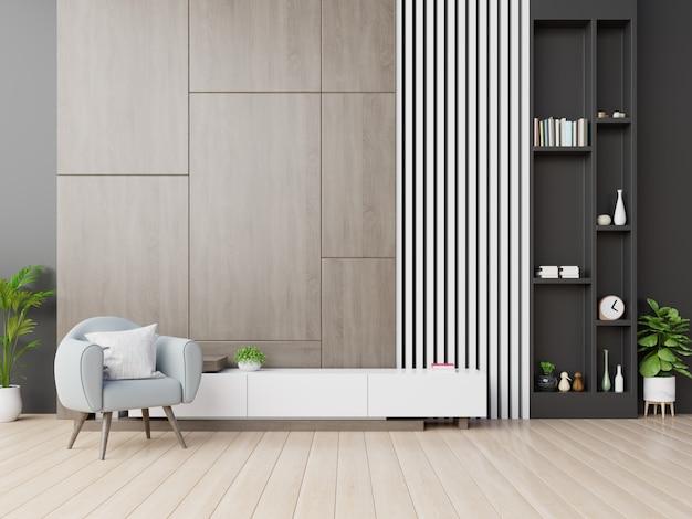 木製の壁に肘掛け椅子とモダンなリビングルームのキャビネットテレビ。 Premium写真