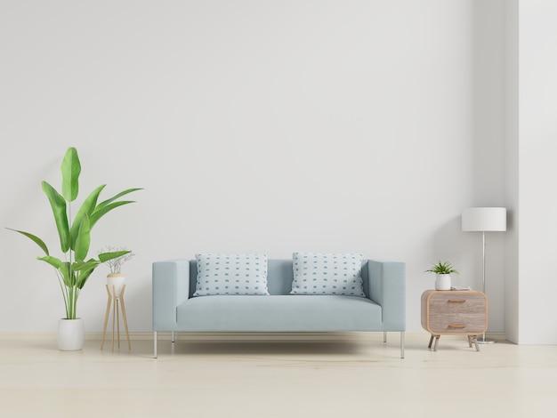 ソファと緑の植物、ランプ、白い壁のテーブルとモダンなリビングルームのインテリア。 Premium写真