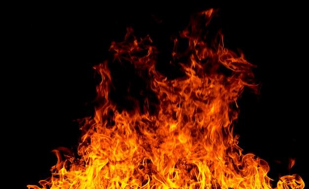 火災のテクスチャは、黒の背景には、飛ぶ火の火花 Premium写真