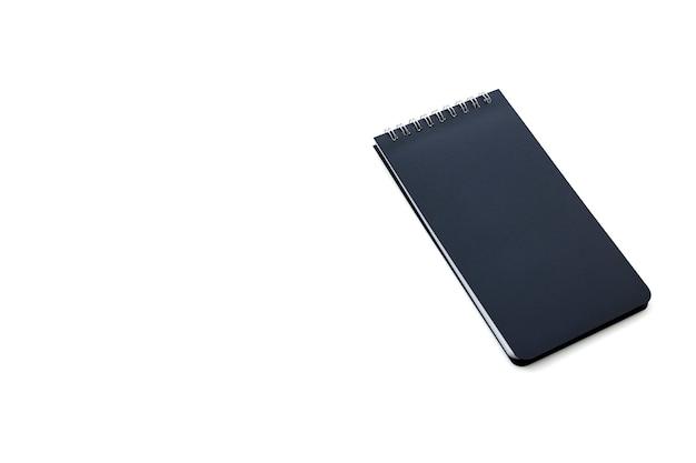 白い背景の上の空白のメモ帳 Premium写真