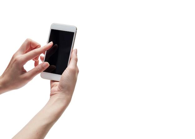 Рука держит мобильный телефон Premium Фотографии