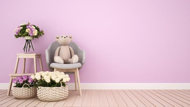 Плюшевый мишка на кресле и цветок в розовой комнате Premium Фотографии