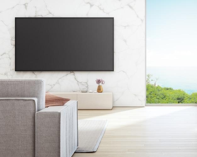 休暇の家または休暇の別荘のソファーと白い大理石の壁にテレビ。 Premium写真