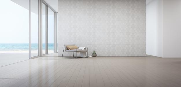 木製の床のドアの近くの肘掛け椅子と豪華なビーチハウスの海ビューリビングルーム。 Premium写真