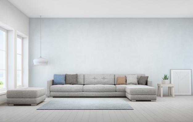 木製コーヒーテーブルと大きなソファーの屋内植物 Premium写真