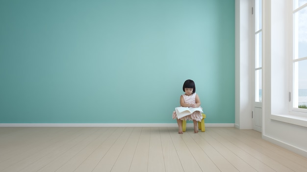 モダンなビーチハウスの子供部屋で本を読む子。 Premium写真