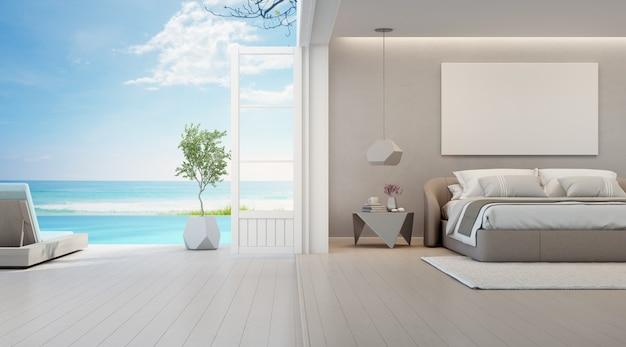 Спальня с видом на море, роскошный летний пляжный домик с двуспальной кроватью возле деревянного пола, терраса и бассейн Premium Фотографии