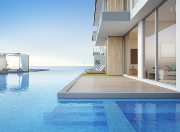 海の見えるスイミングプールとモダンなデザインの空のテラス付きの高級ビーチハウス。 Premium写真
