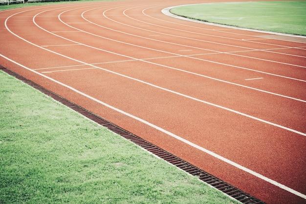 Беговая дорожка для спортивного соревнования текстуры. Premium Фотографии