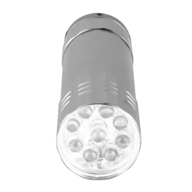 懐中電灯の小さな白い壁に分離 Premium写真