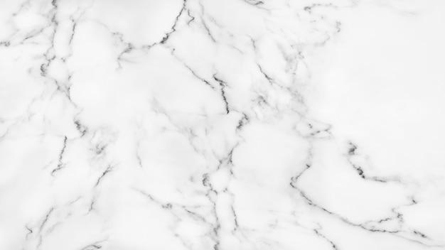 Белая мраморная текстура для предпосылки. Premium Фотографии